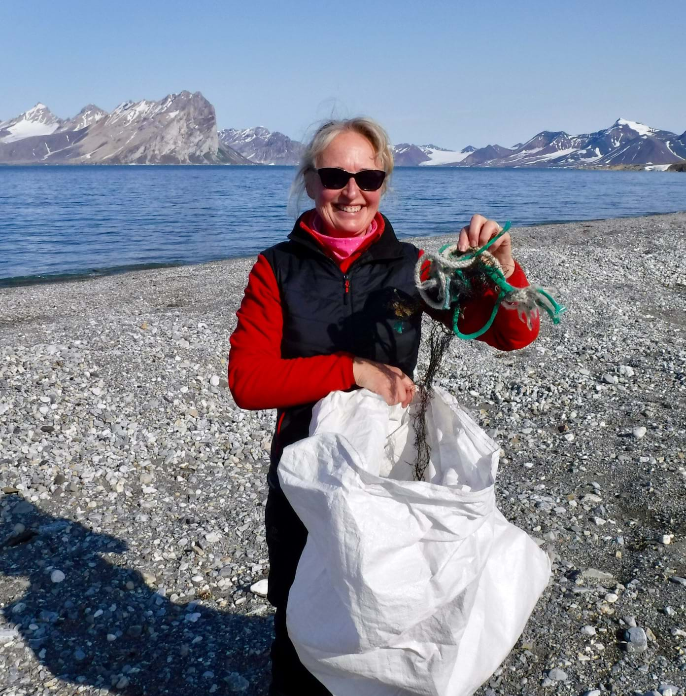 Regional Manager Julie Waites on a beach in Norway picking up litter