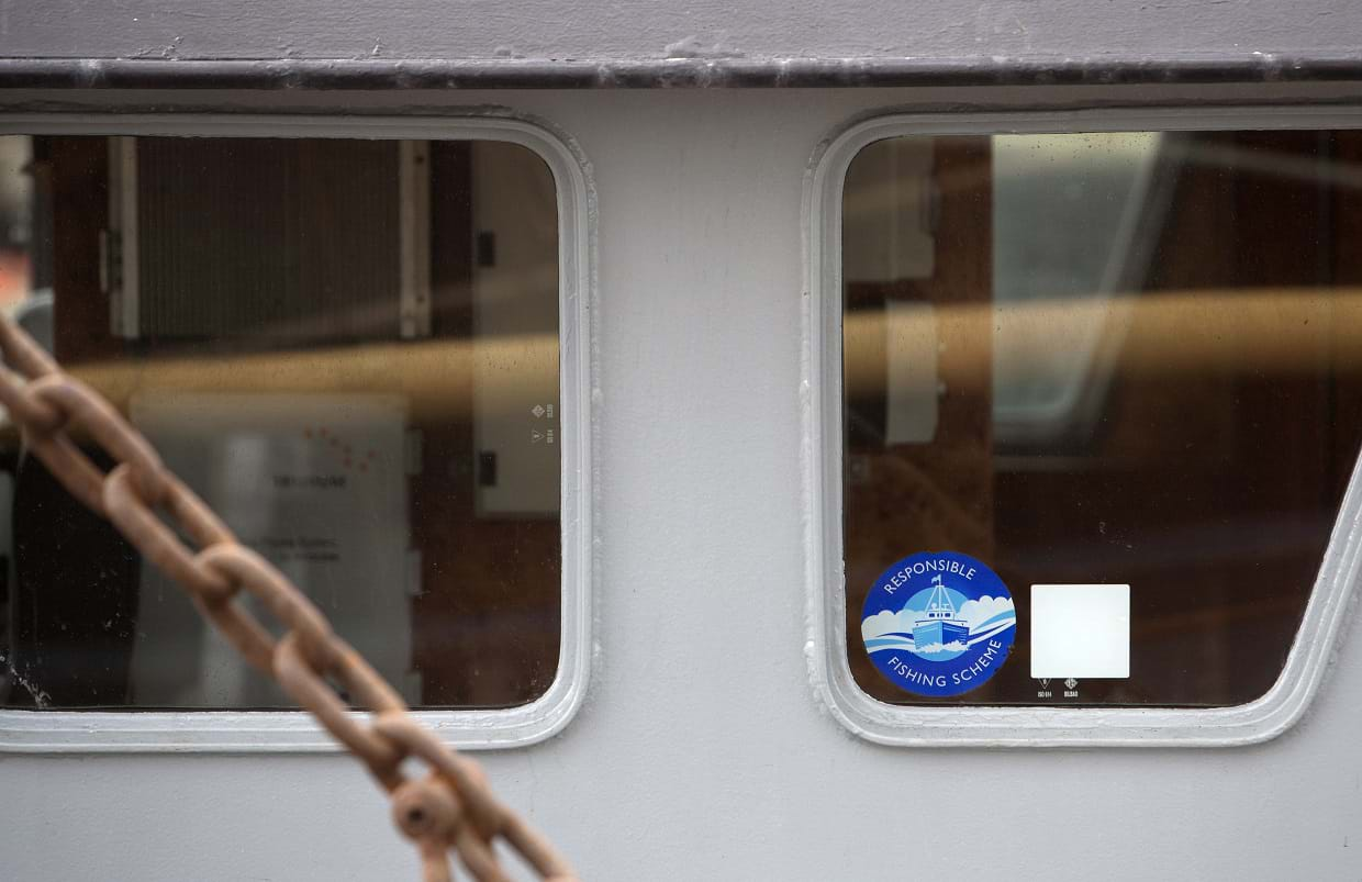 Photo with close up view of window on fishing vessel wheelhouse