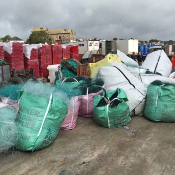 Photo of large bags full of fishing nets